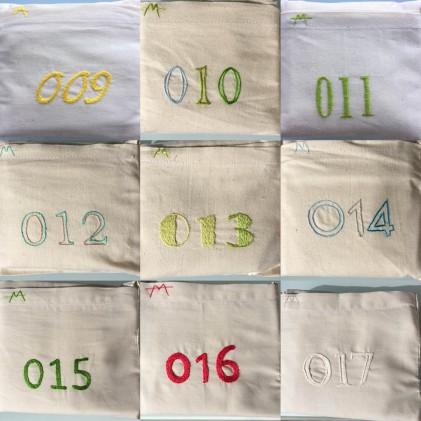 Números bordados a mano